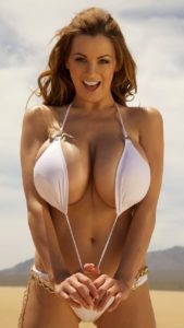 Sexy bikini model in white swimsuit. She looks happy.