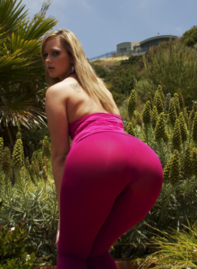 Curvy blonde in tight pink pants leaning forward showing off her big ass.