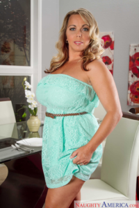 Sexy mature blonde standing in strapless dress.