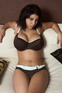 Dark haired Lena in brown bikini with nice cleavage.